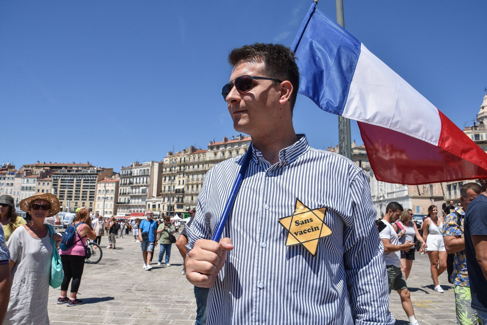 July 17, 2021, Marseille, France: Protester holds a French flag and flaunts a Jewish yellow star on his chest during th
