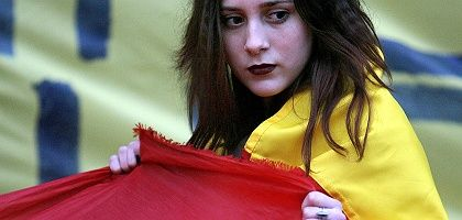A student holds a Romanian flag in Bucharest, Romania, in support of Moldovan protesters. Moldova's Communist government has complained of Romanian meddling in the recent election unrest.