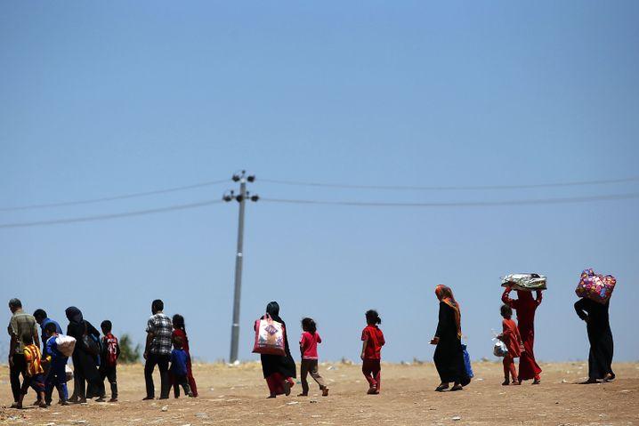 Iraker auf der Flucht: Tausende Menschen mussten vor dem IS bereits fliehen
