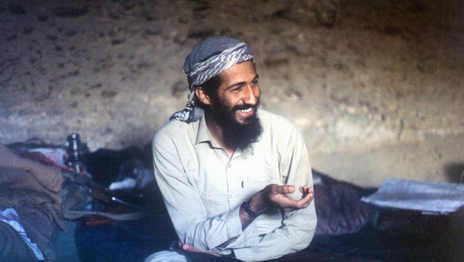 A 1988 photo shows Osama bin Laden smiling as he sits in a cave in Afghanistan's Jalalabad region. The al-Qaida mastermind was killed by US forces on May 1.