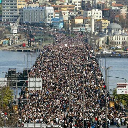 Thousands of people march through Unkapani bridge over the Golden Horn during the funeral procession of Turkish-Armenian editor Hrant Dink in Istanbul in January.
