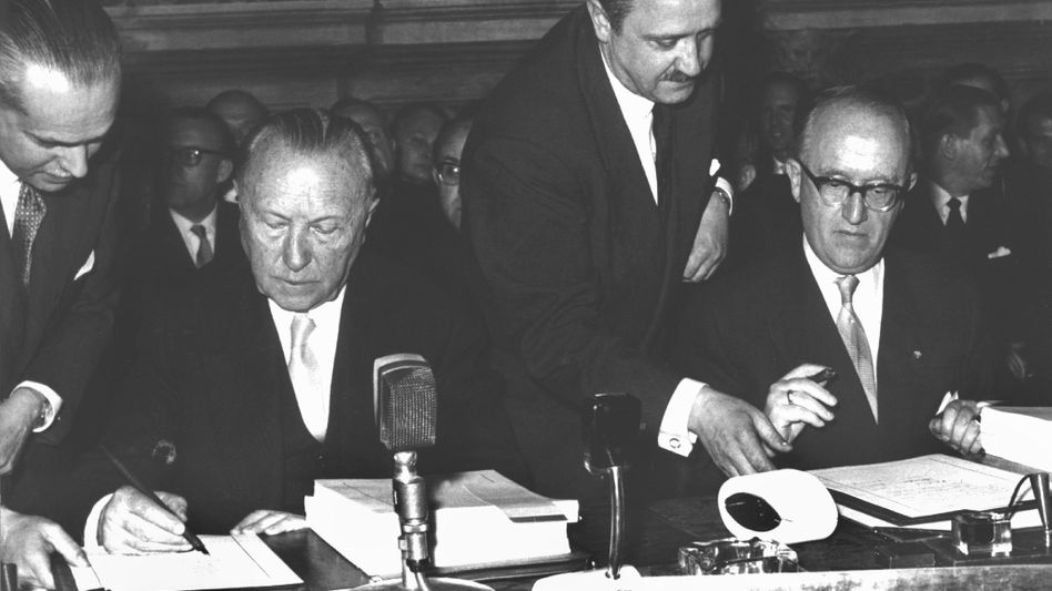 German Chancellor Konrad Adenauer (l) and senior Foreign Ministry official Walter Hallstein during the 1957 signing of the Treaty of Rome, which established the predecessor of the European Union.