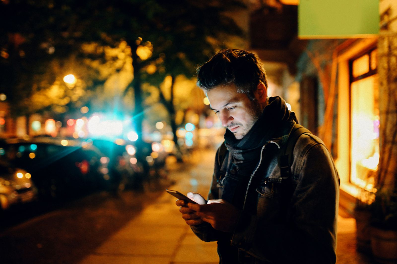 Young man texting in Berlin