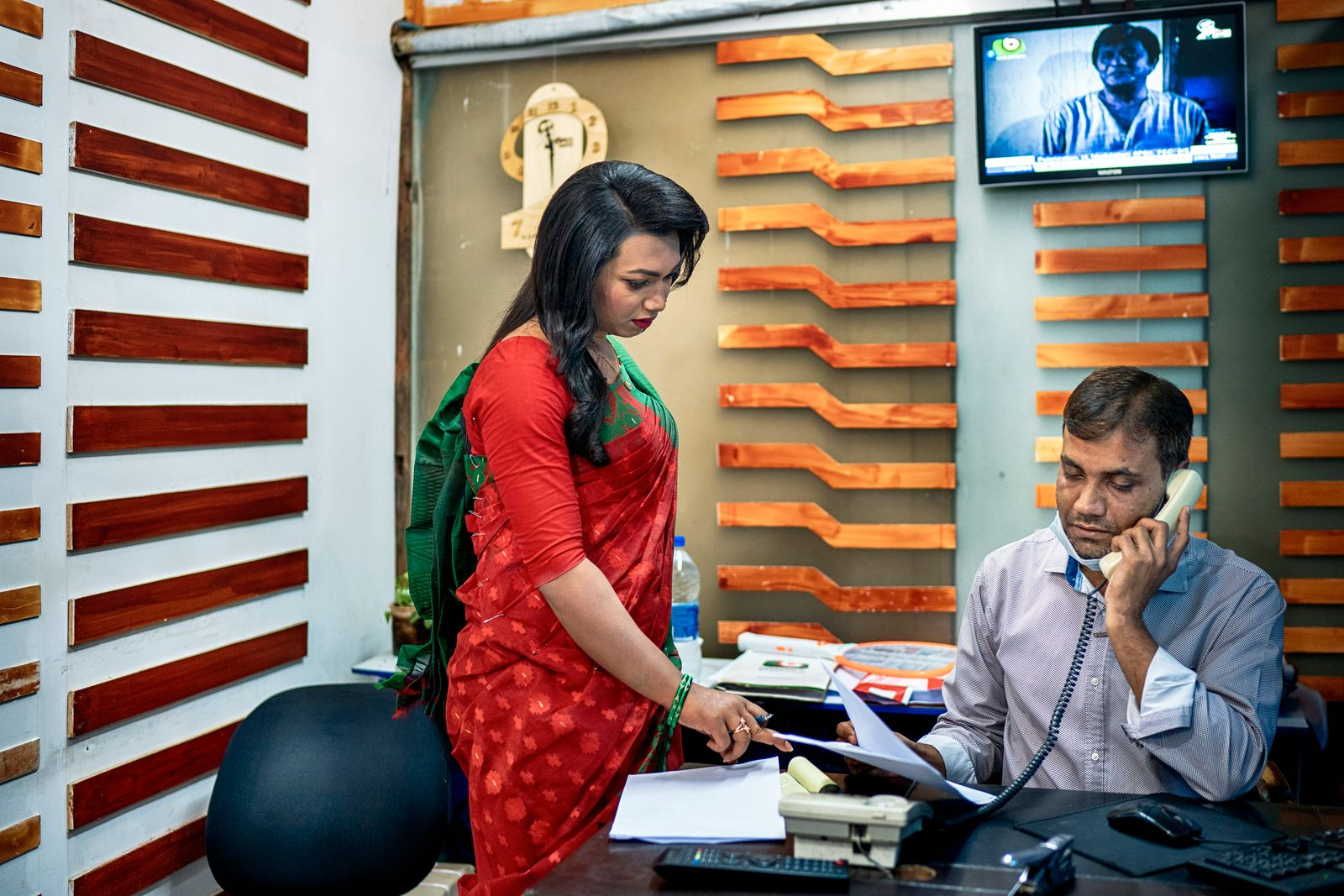 Tashnuva Anan Shishir, left, confers with a colleague at the Boishakhi TV studio in Dhaka, Bangladesh, on Saturday, March 13, 2021. (Fabeha Monir/The New York Times)