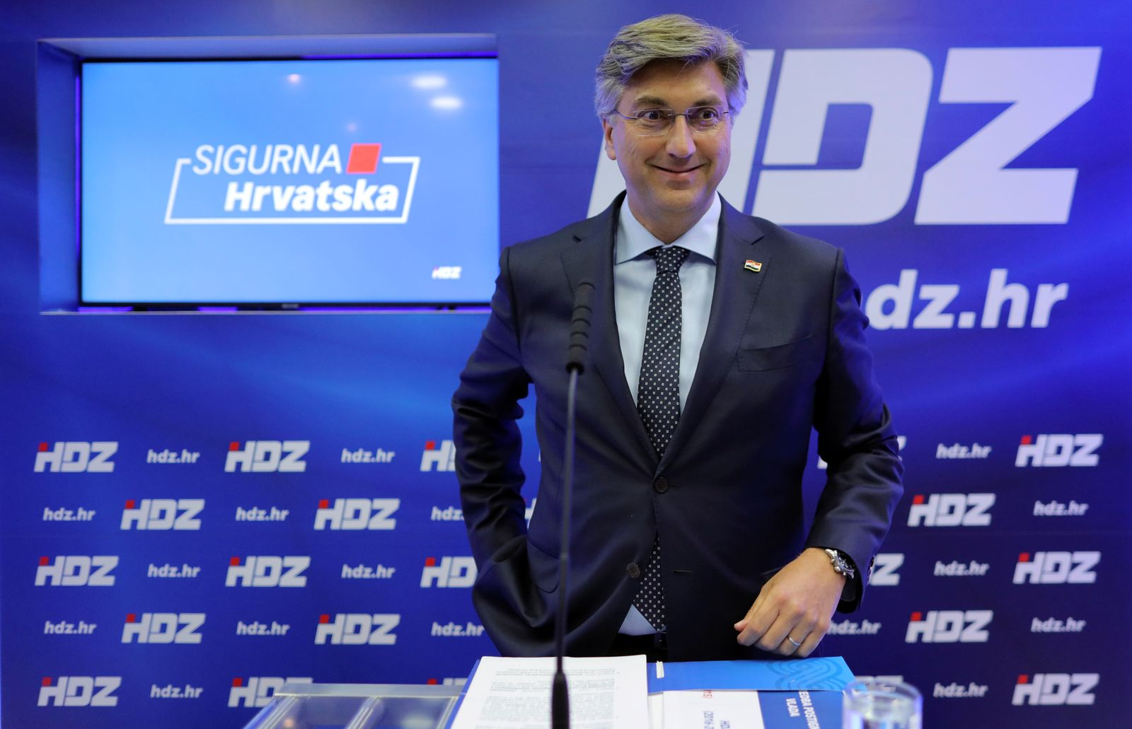 Croatian Prime Minister Andrej Plenkovic talks to the media at party headquarters, ahead of parliamentary elections, in Zagreb