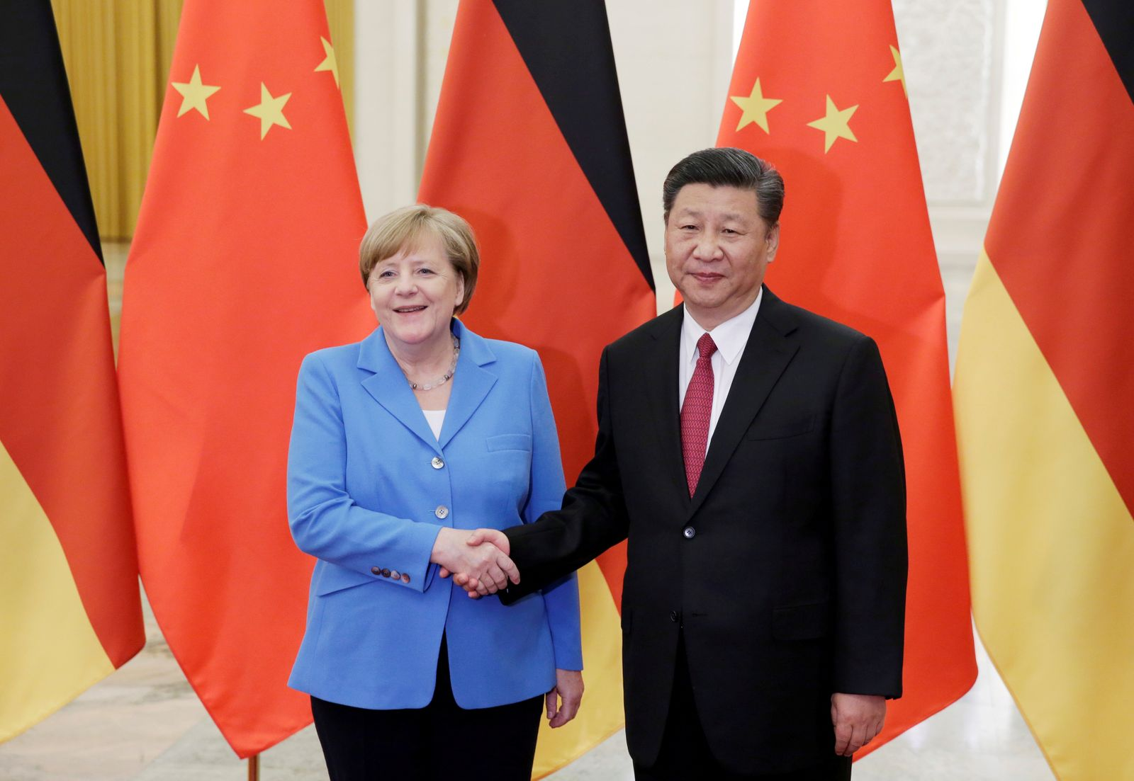 FILE PHOTO: China's President Xi Jinping meets German Chancellor Angela Merkel at the Great Hall of the People in Beijing