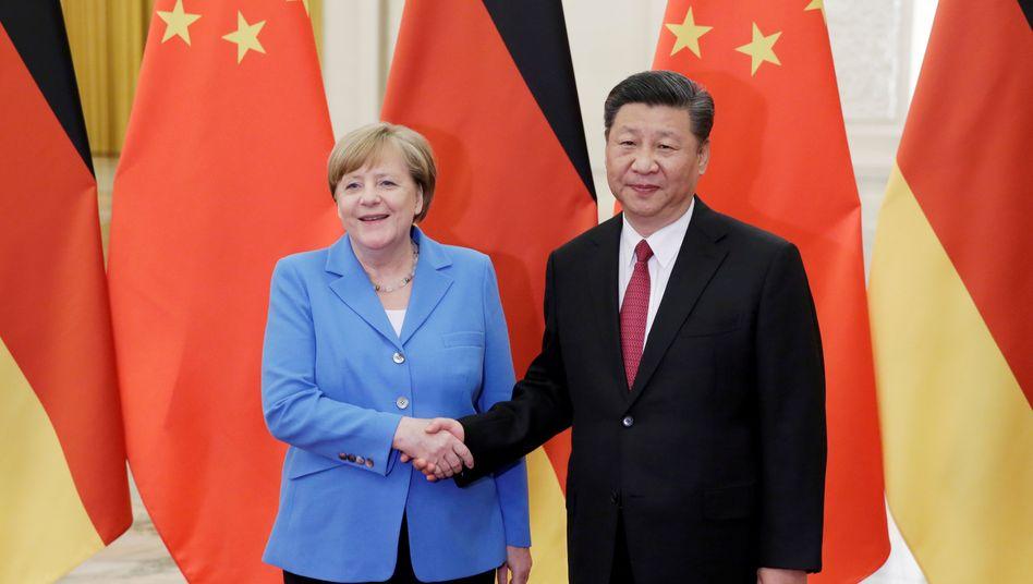 Kanzlerin Merkel, Präsident Xi (im Mai 2018 in Peking)