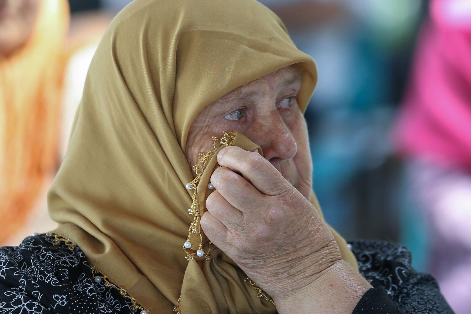 Srebrenica survivors watch the final verdict of Ratko Mladic in Potocari
