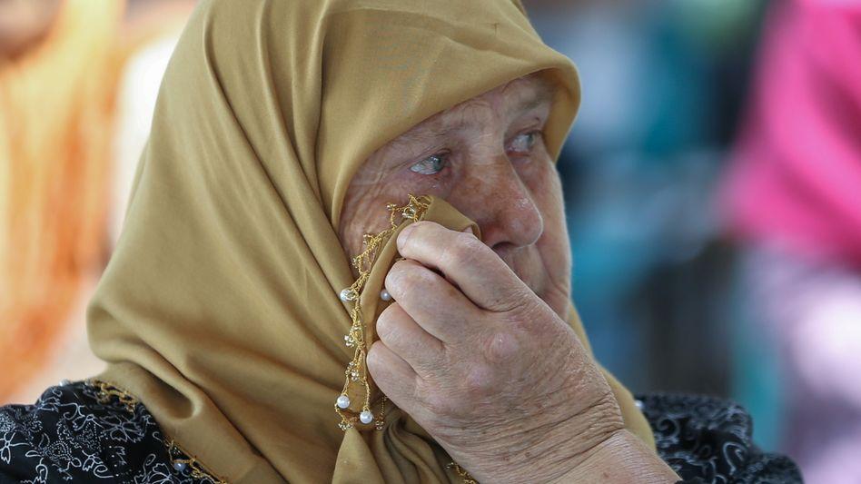 Eine Muslima aus Bosnien nach der Verkündung des letztinstanzlichen Urteils