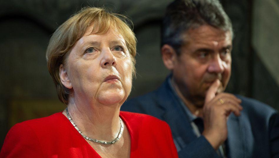 Kanzlerin Merkel und der frühere SPD-Chef Gabriel