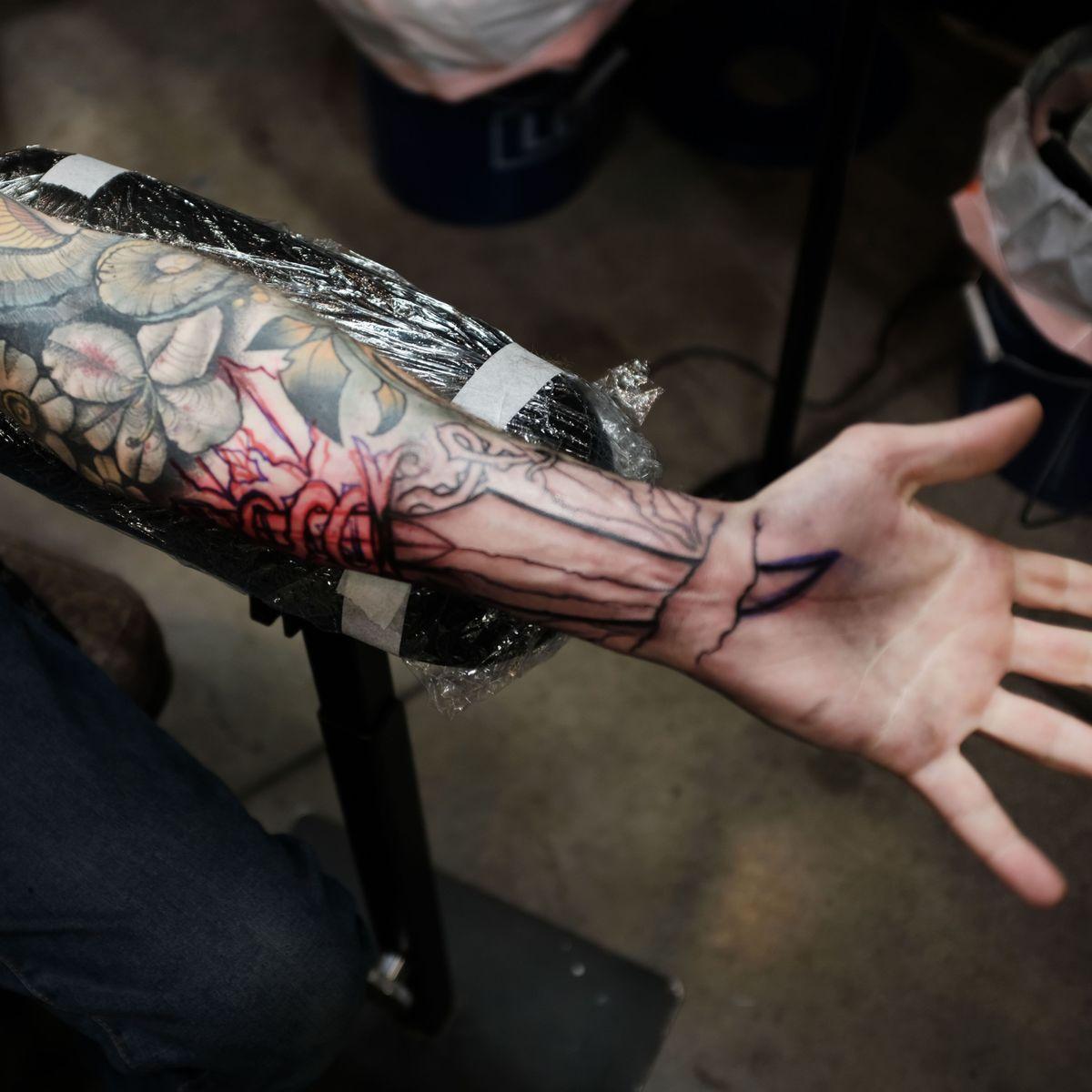schlangen tattoos unterarm