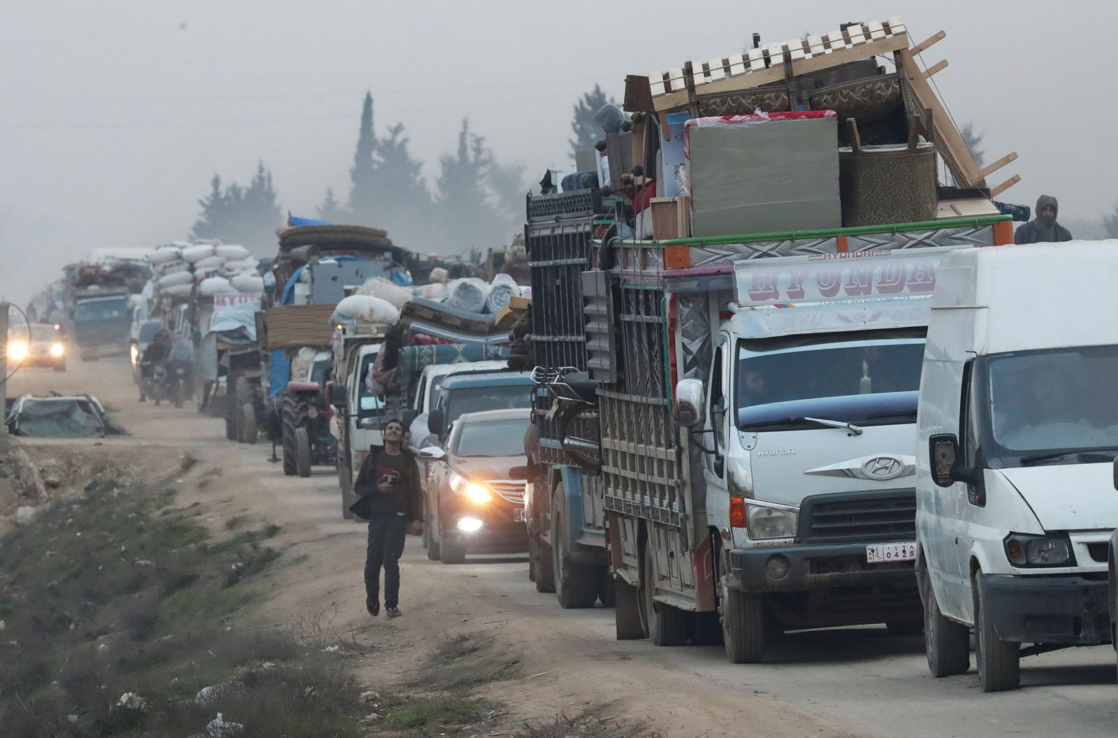 FILE PHOTO: A view of trucks carrying belongings of displaced Syrians, is pictured in the town of Sarmada in Idlib province