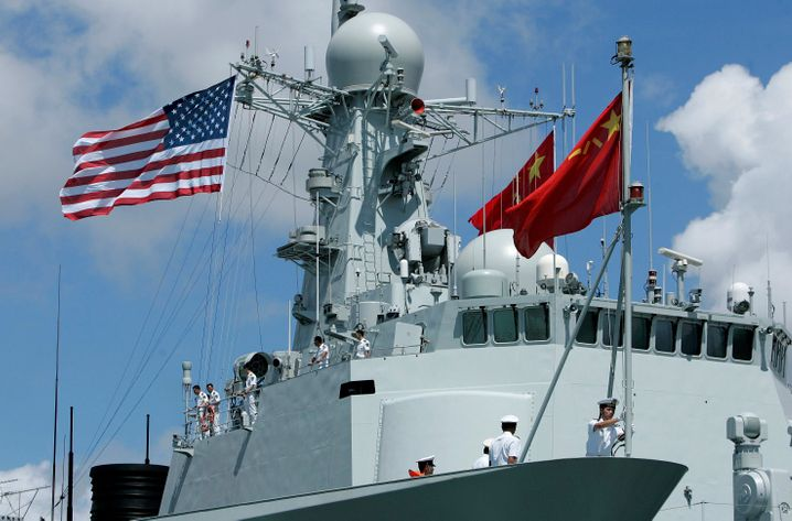 The U.S. and Chinese flags during a naval maneuver in Pearl Harbor, Hawaii, in June 2016