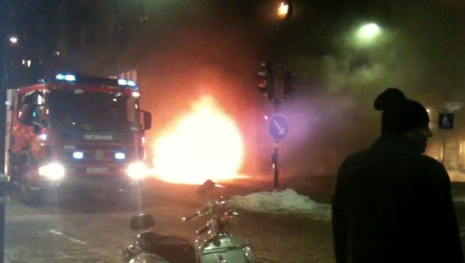 A video grab shows a fire engine arriving at the scene of a car explosion on December 11, 2010 in Stockholm. An Iraqi-born Swedish man blew himself up about 200 yards away.