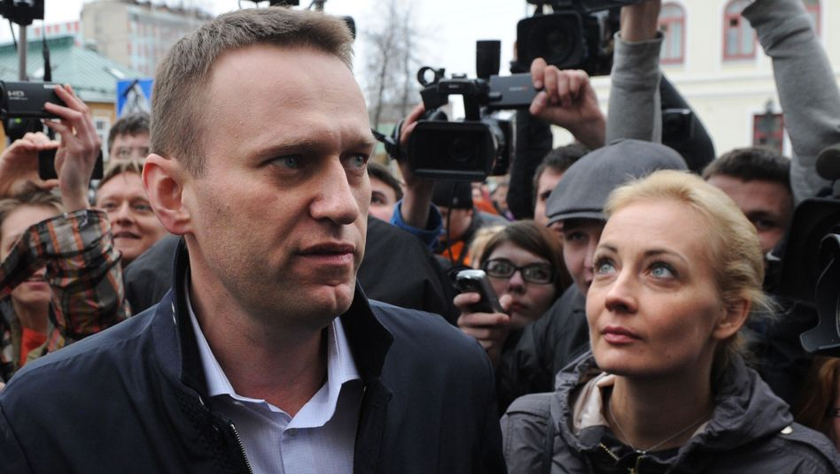 Russian blogger and opposition leader Alexei Navalny and his wife, Yulia, meet journalists outside the court in the town of Kirov on April 17.