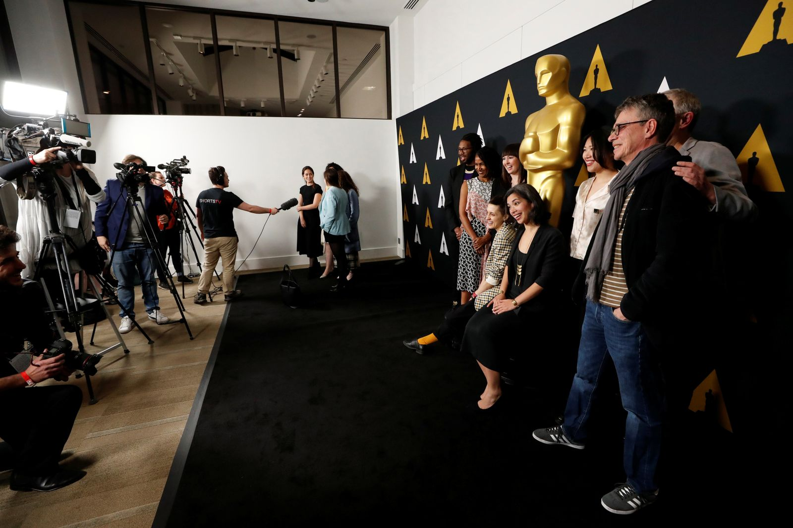 Nominees for an Oscar for Best Short Film (Animated) pose at a reception at the Academy of Motion Picture Arts and Sciences in Beverly Hills