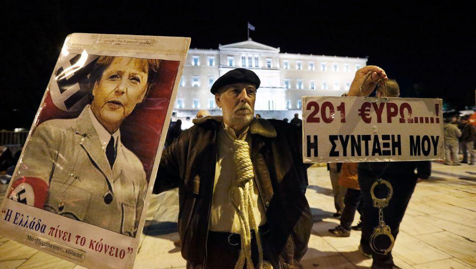 """Anti-Merkel-Protest in Athen (2013): """"Die EU hat uns nichts zu diktieren"""""""