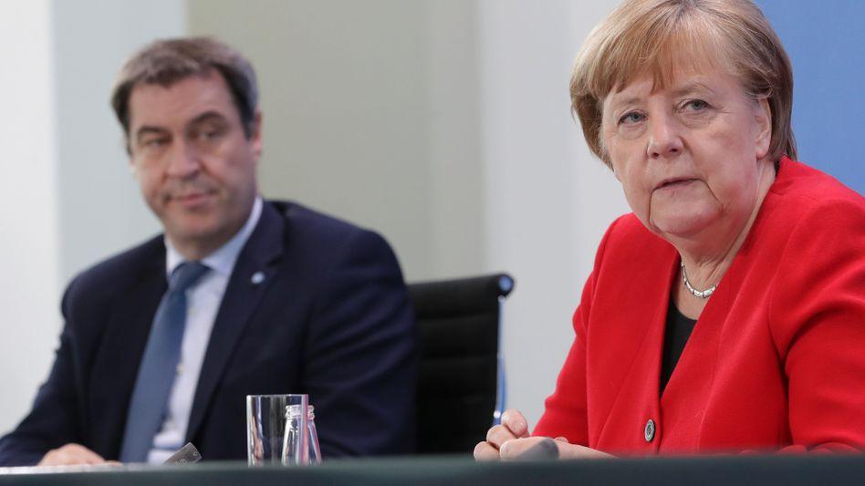 Bayerns Ministerpräsident Markus Söder, Kanzlerin Angela Merkel: Der CSU-Chef wünscht sich eine stärkere Führung des Bundes