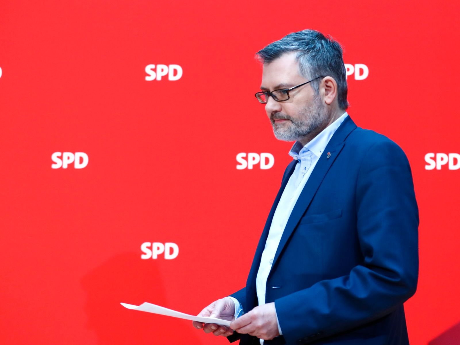 Nietan of Social Democratic Party (SPD) arrives to the news conference to announce the results of the voting about forming for a possible coalition between SPD and CDU in Berlin