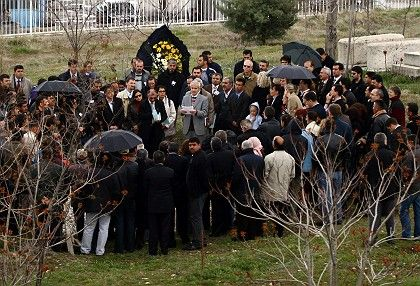 Family members and friends of Tilman Geske gather at an Armenian cemetery for his funeral in Malatya on Friday April 20.