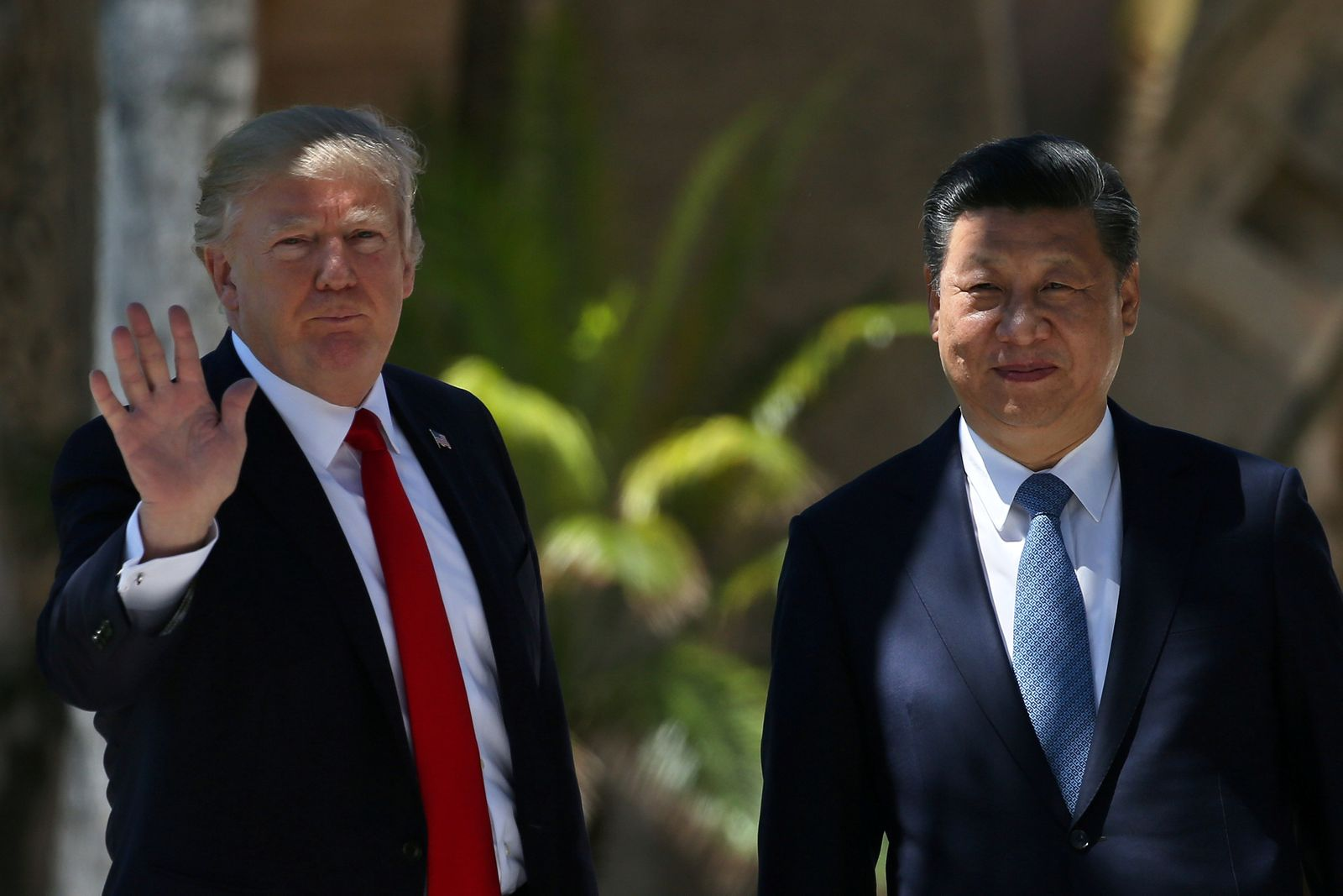 FILE PHOTO: U.S. President Trump waves as he and China's President Xi walk along the front patio of the Mar-a-Lago estate after a bilateral meeting in Palm Beach