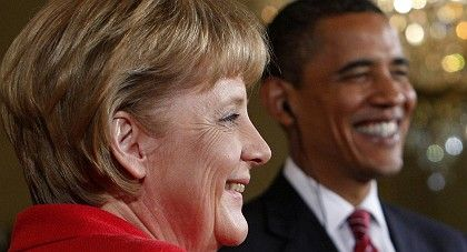 US President Barack Obama shares a laugh with German Chancellor Angela Merkel during a news conference in the White House.
