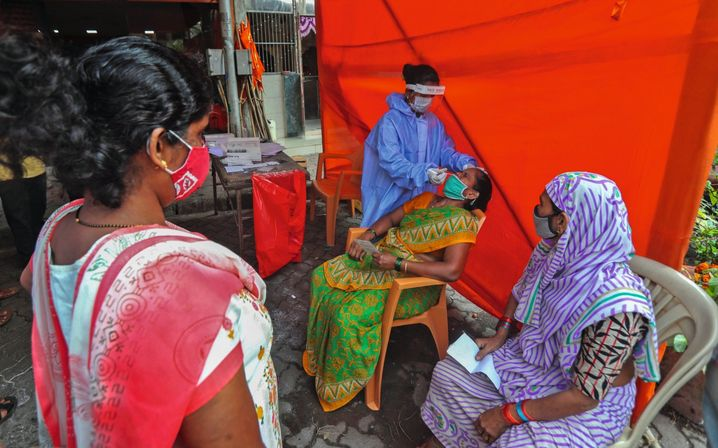 "A coronavirus testing center in India: ""Most countries simply can't afford these vaccines."""