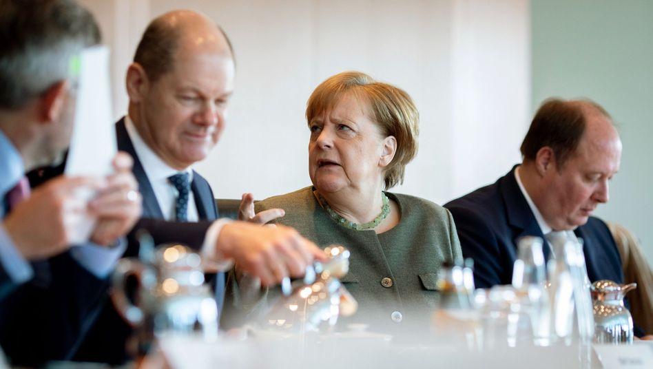Bundeskanzlerin Merkel, Finanzminister Scholz