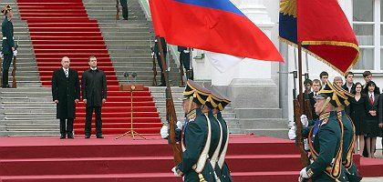 Vladimir Putin and Dmitry Medvedev at a military parade in Moscow in May.