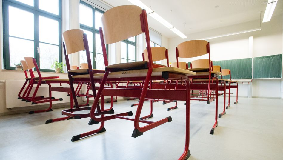 Chairs in an empty classroom in Leipzig, Germany: Schools are closing down across the country this week.