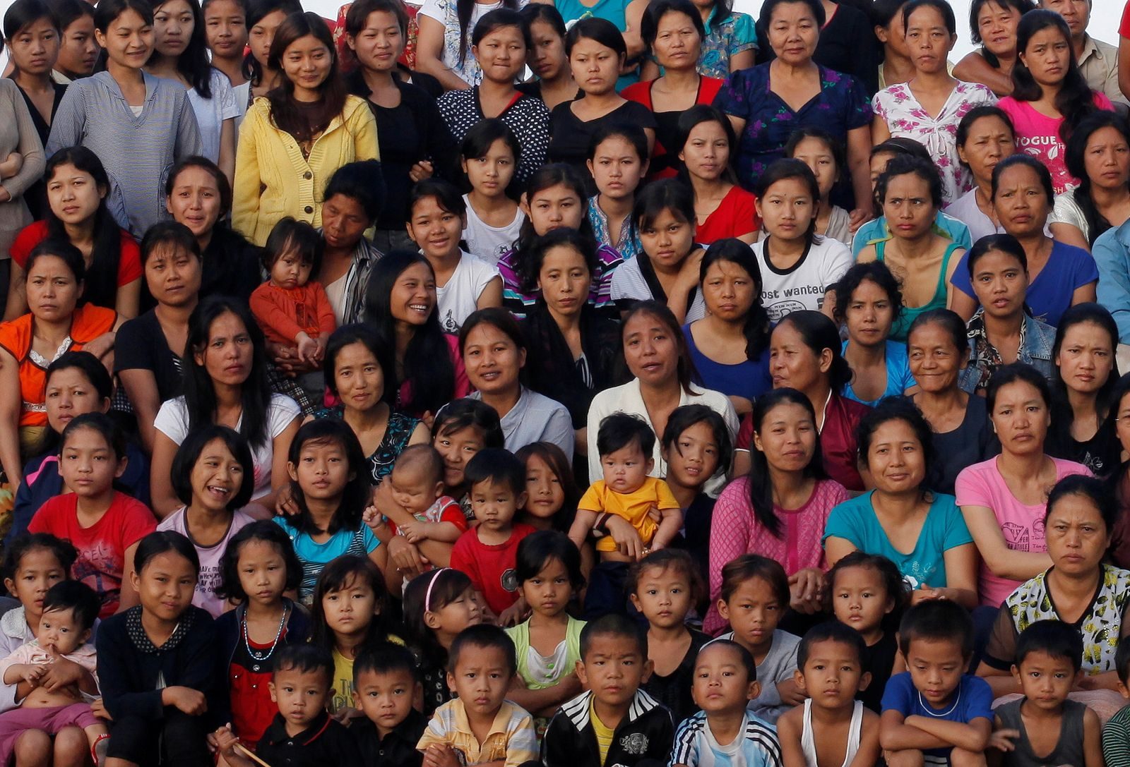 FILE PHOTO: Family members of Ziona poses for group photograph outside their residence in Baktawng