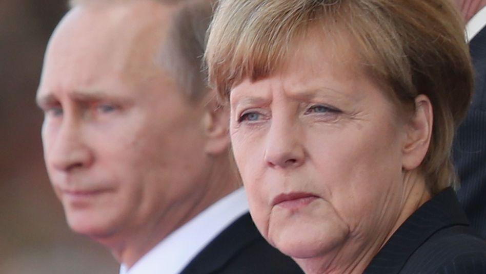 Putin und Merkel: Heikle Einladung aus Moskau