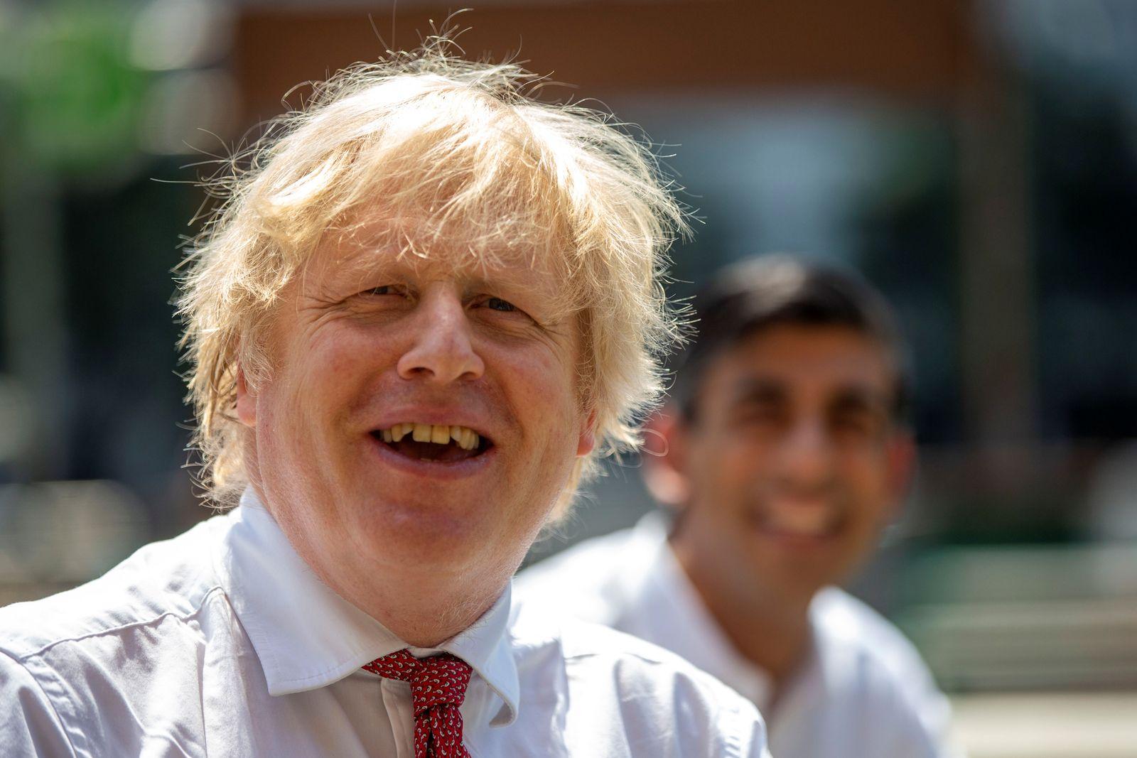Britain's Prime Minister Boris Johnson and Chancellor Rishi Sunak visit Pizza Pilgrims in West India Quay, in London