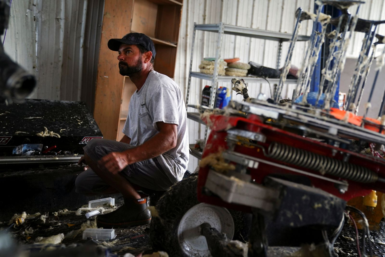 Brent Morvant cleans up his paint and body shop after Hurricane Laura passed through the area in Cameron Parish