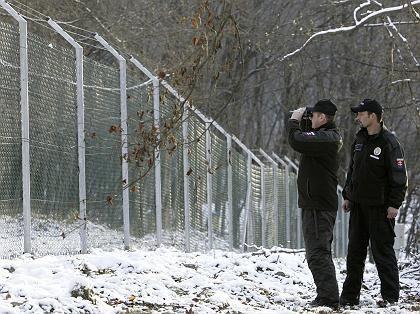 Slovakian border guards looking across the EU's eastern border into Ukraine.