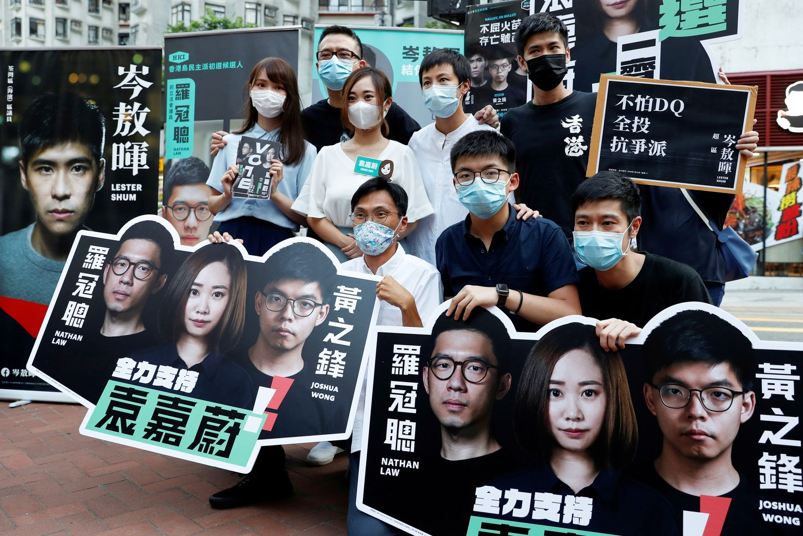 FILE PHOTO: Agnes Chow, Anthony Wong Yiu Ming, Tiffany Yuen Ka-wai, Denise Ho Wan See, Lester Shum, Eddie Chu, Joshua Wong and Gregory Wong pose for photo at a campaigning during primary elections aimed for selecting democracy candidates, in Hong Kong