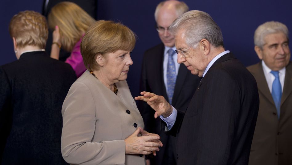 German Chancellor Angela Merkel and Italian Prime Minister Mario Monti in Brussels on Thursday night.