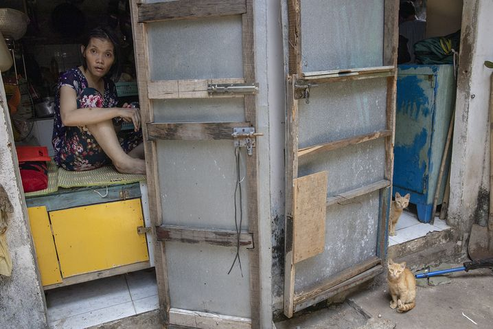 Nguyen Van Bat's second daughter Nguyen Le Thanh is severely disabled as a result of her father's exposure to Agent Orange.