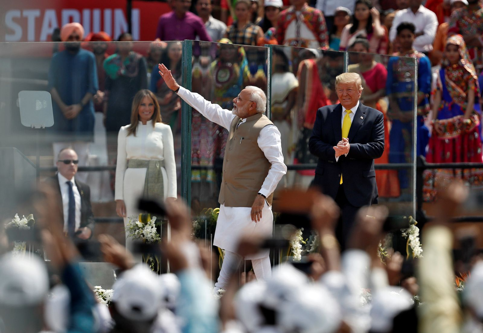 "India's Prime Minister Narendra Modi waves next to U.S. President Donald Trump and first lady Melania Trump as they attend the ""Namaste Trump"" event at Sardar Patel Gujarat Stadium, in Ahmedabad"
