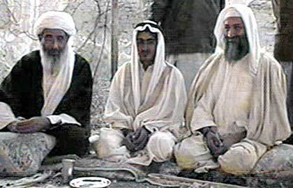 Osama bin Laden with his son Mohammed and Mohammed Atif.