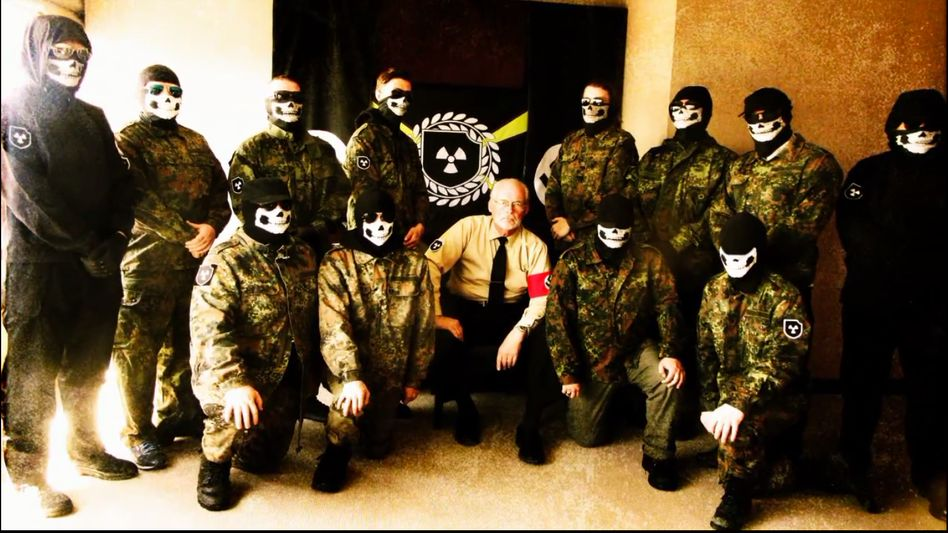 Members of the Atomwaffen Division in the U.S., together with neo-Nazi ideologue James Mason.