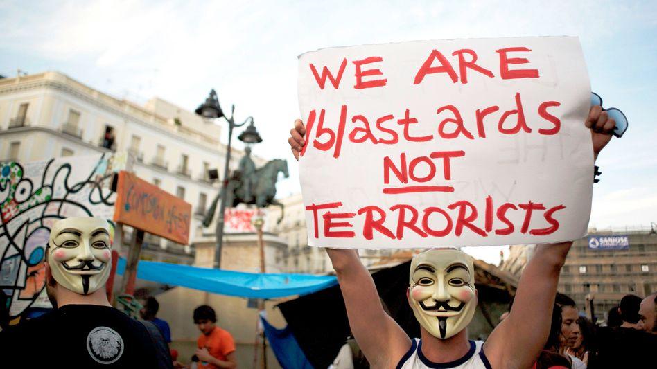 Anonymous-Aktivisten am Sonntag in Spanien: Schweinehunde, keine Terroristen?