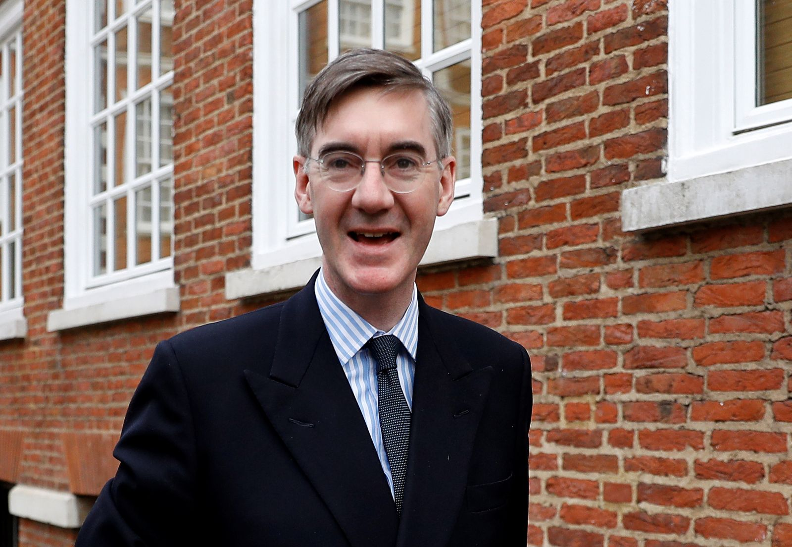 Britain's Conservative Party MP JacobRees-Mogg leaves his home in London