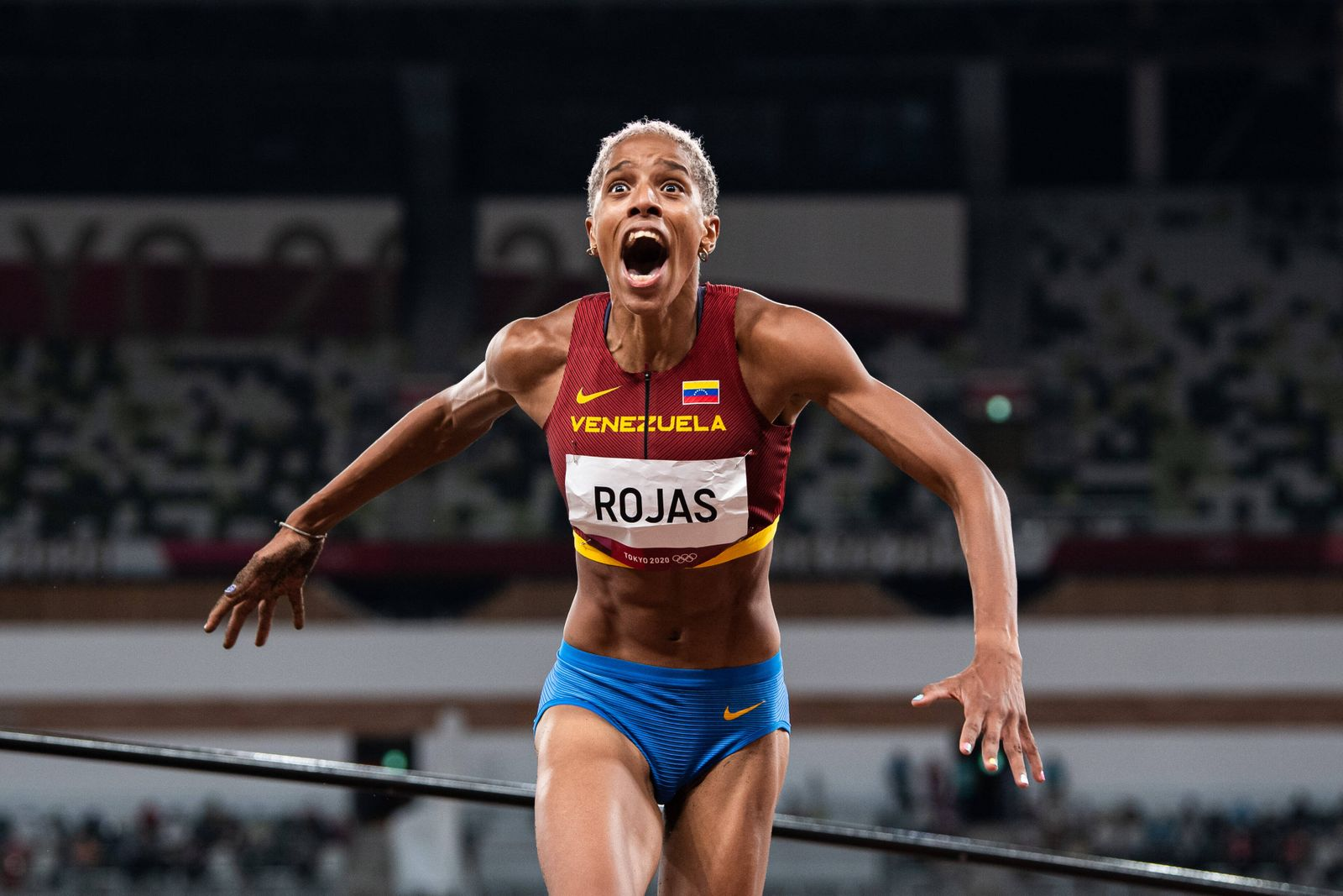 """210801 Yulimar Rojas of Venezuela celebrates after setting a new world record when competing in women""""!s triple jump fin"""