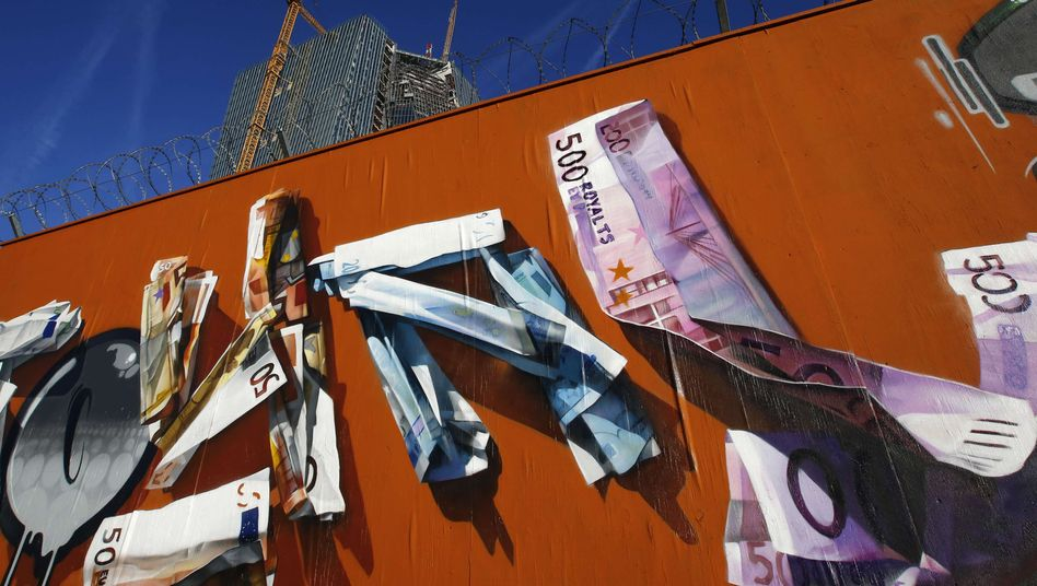 Graffiti is seen on the fence surrounding the construction site of the new headquarters of the European Central Bank in Frankfurt.