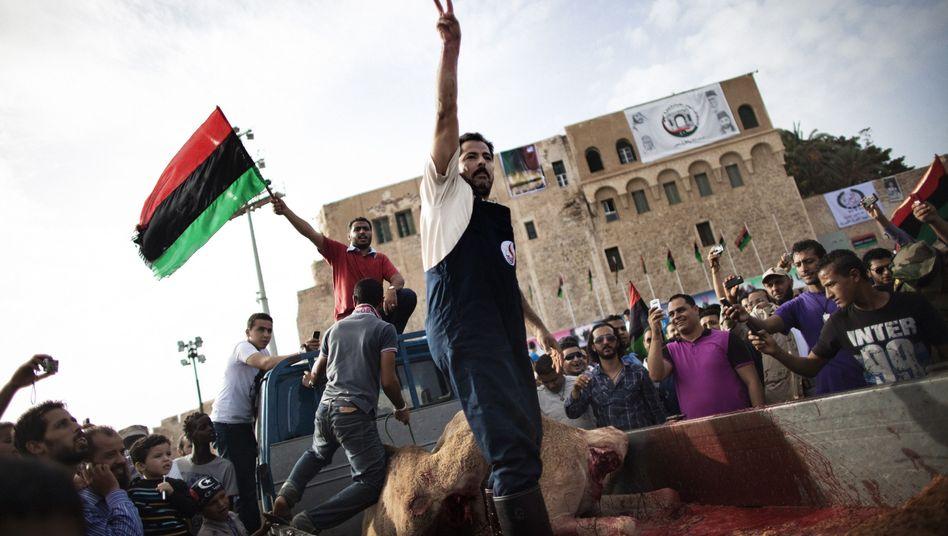 Feierlichkeiten in Tripoli: Ende jahrzehntelanger Diktatur
