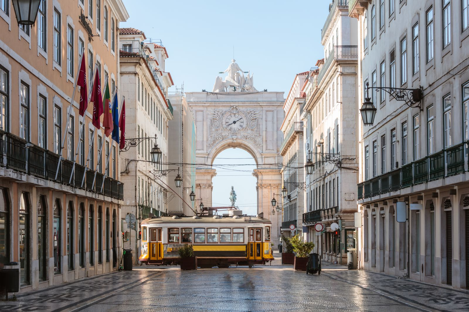 Tram in front of Rua Augusta arch, Lisbon, Portugal