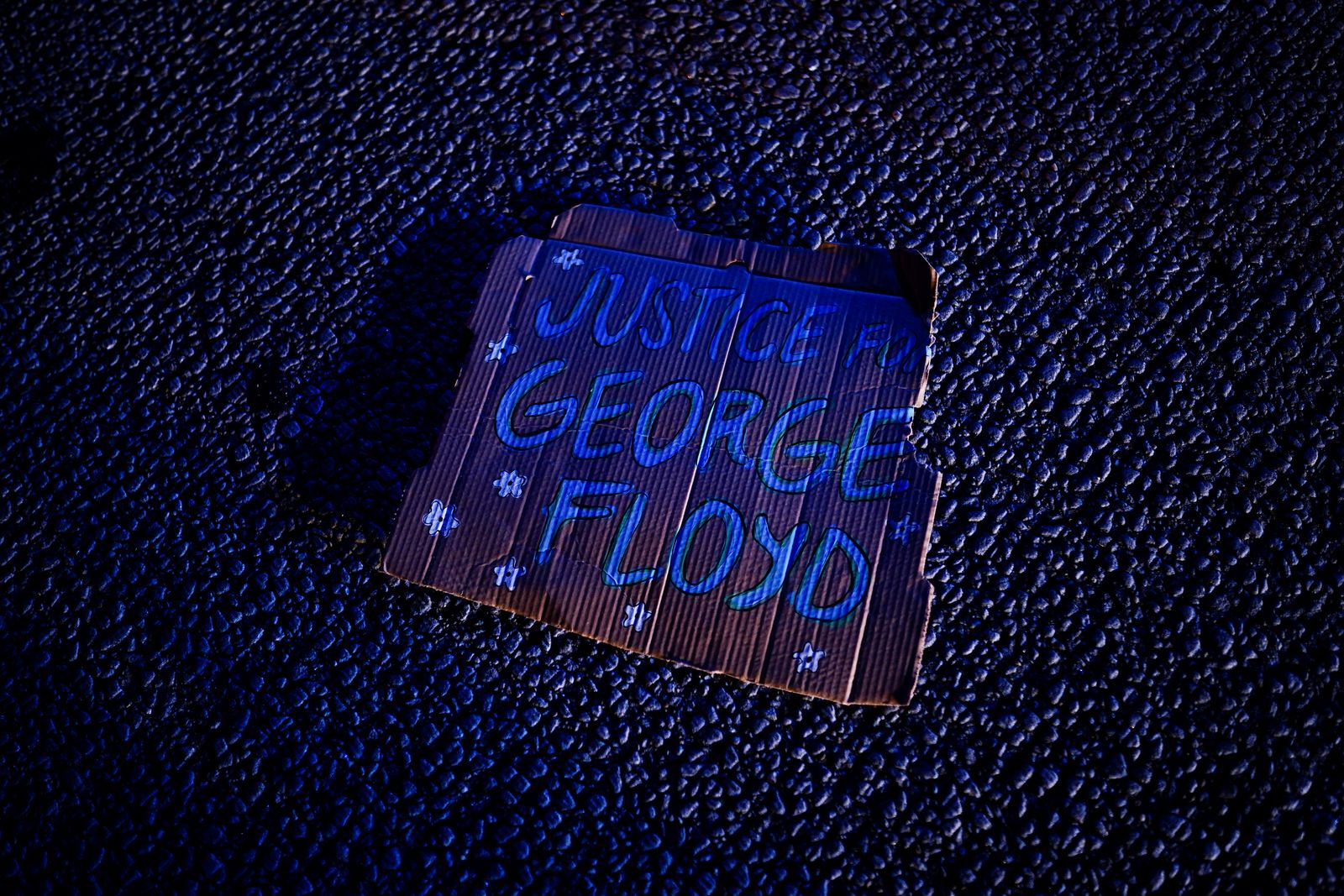 A sign referencing George Floyd is seen on the freeway during a rally against racial inequality and the police shooting death of Rayshard Brooks, in Atlanta