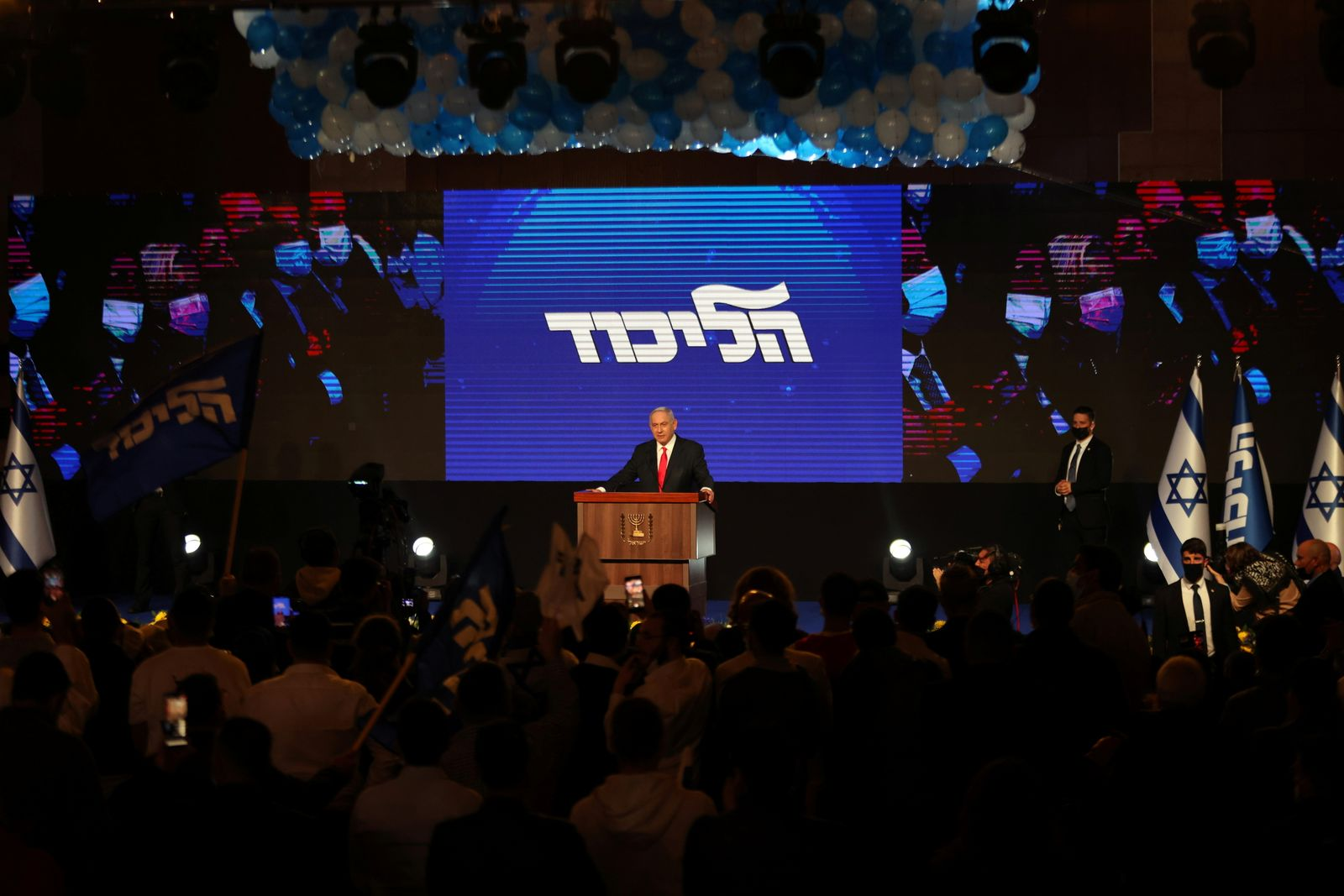 Israeli Prime Minister Benjamin Netanyahu delivers a speech to supporters following the announcement of exit polls in Israel's general election at his Likud party headquarters in Jerusalem