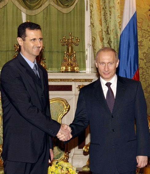 Syrian President Bashar al-Assad and Russian President Vladimir Putinshake hands during their meeting in at the Kremlin, in Moscow.